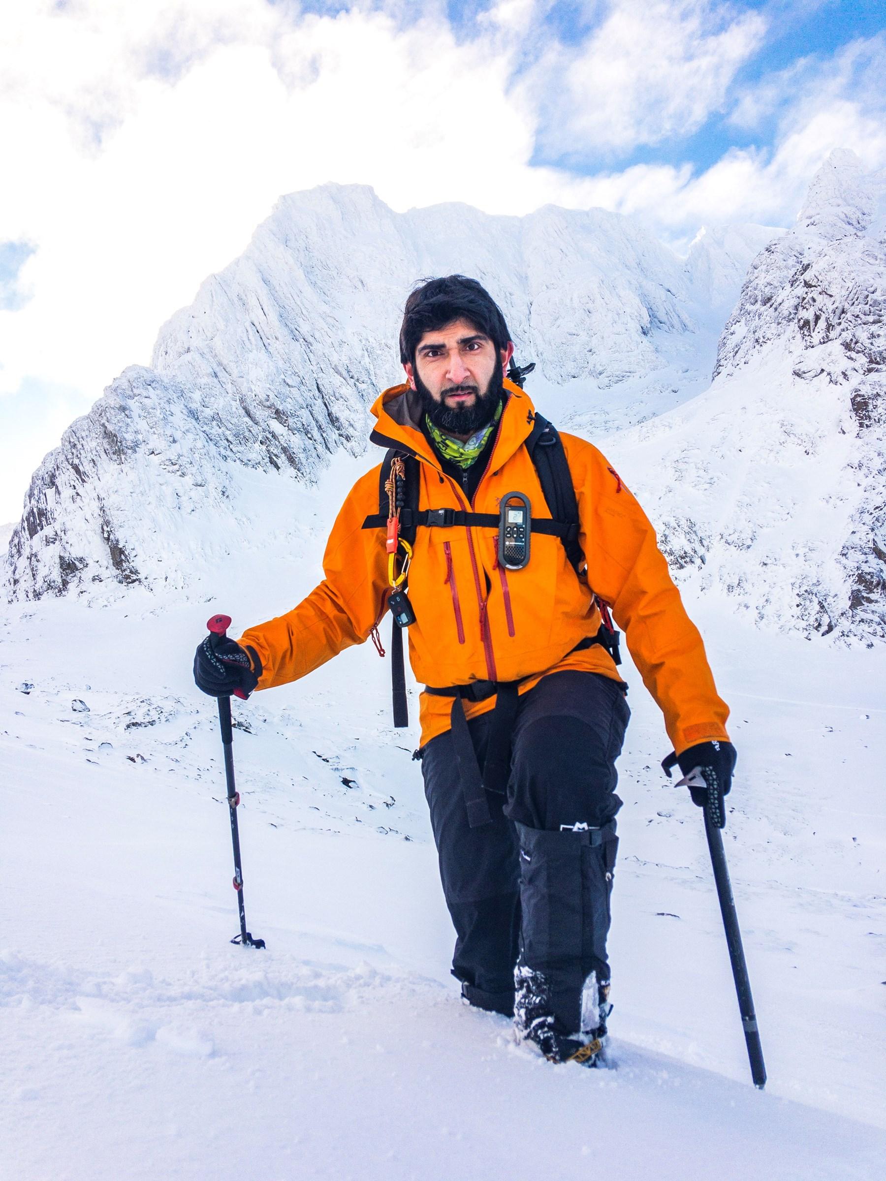 Mahroof Malik climbing mountain in the snow