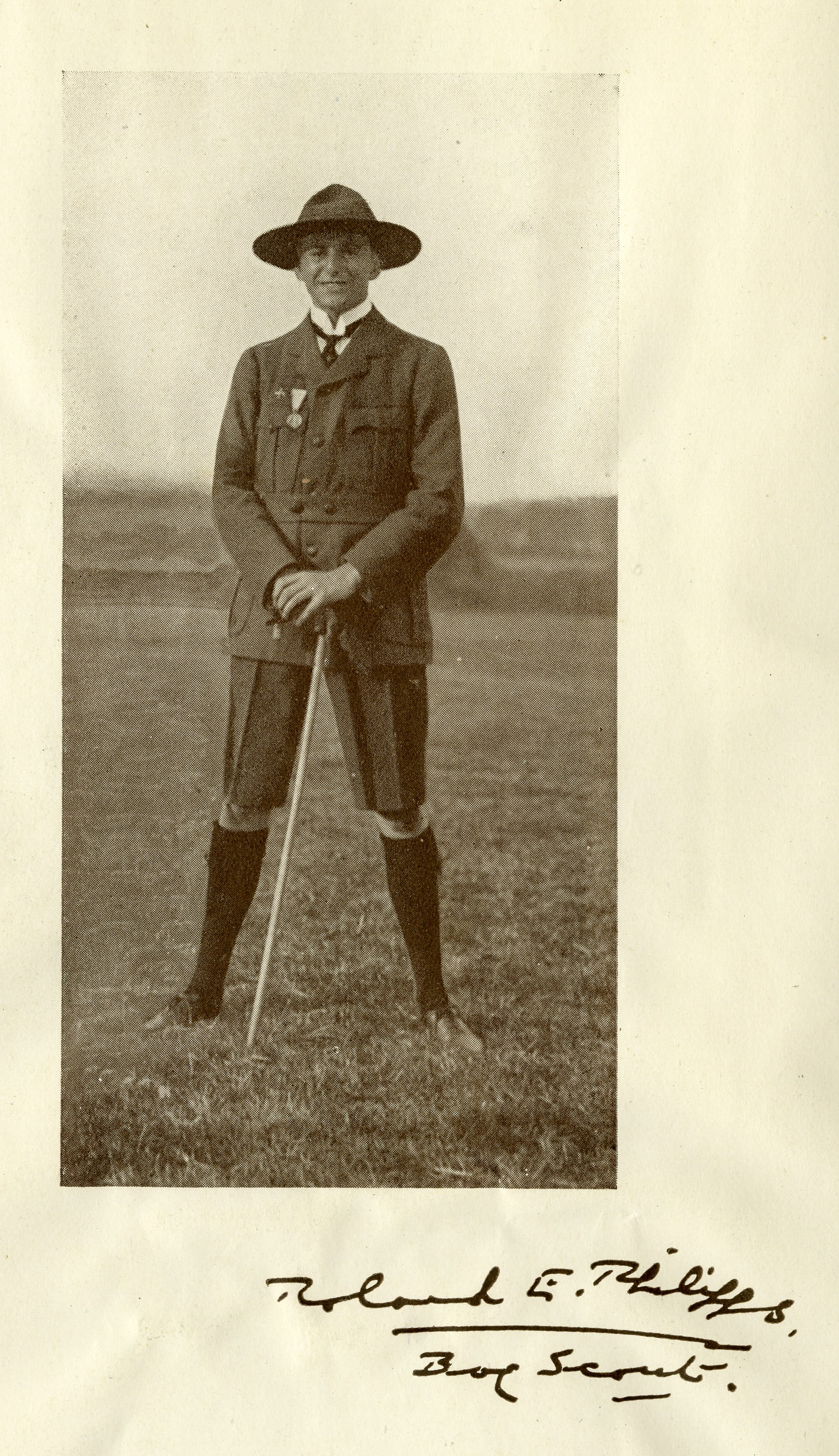 A photograph of Roland Philipps wearing his Scout uniform with pride.