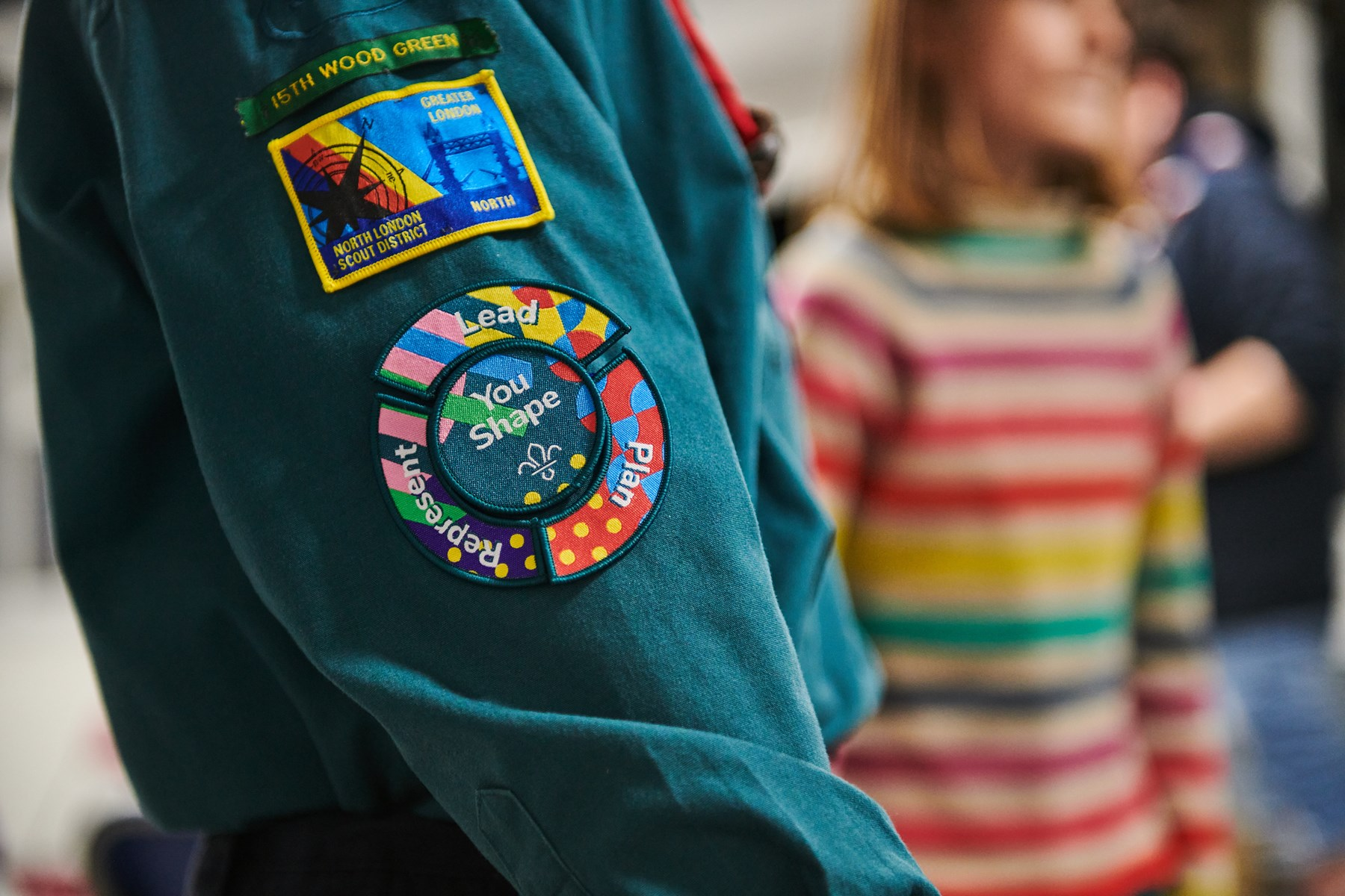 A picture of the Youshape award on a young person's uniform