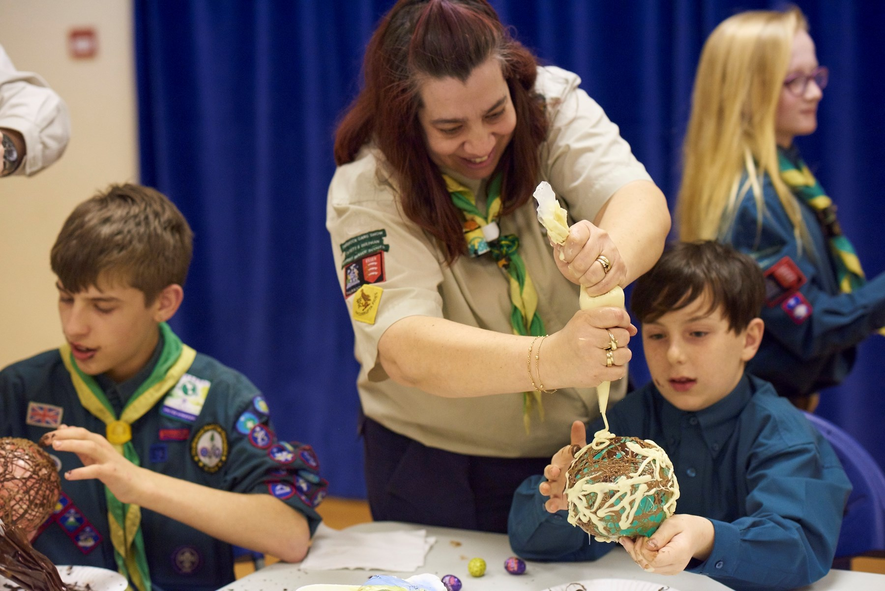 Adult helping Scouts